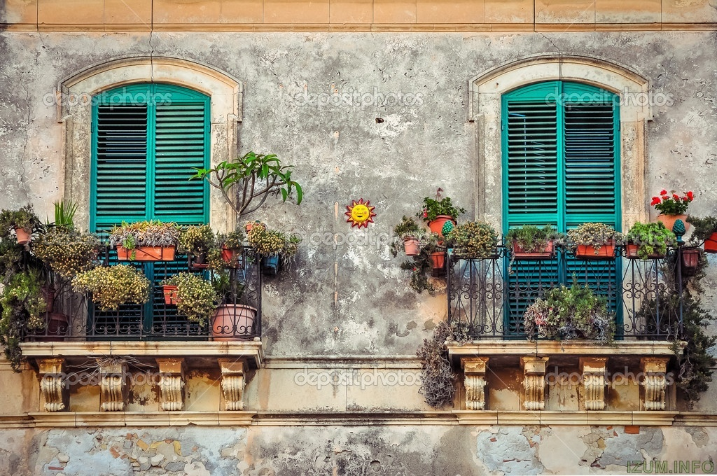 depositphotos_29874167-stock-photo-beautiful-vintage-balcony-with-colorful.jpg